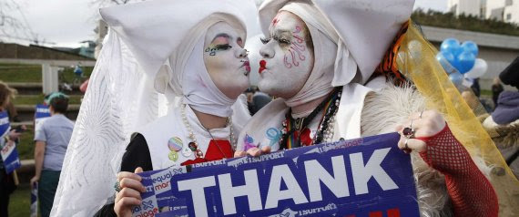 Supporters attend a symbolic same-sex marriage outside the Scottish Parliament in Edinburgh, Scotland February 4, 2014. Scotland2014. Scotland